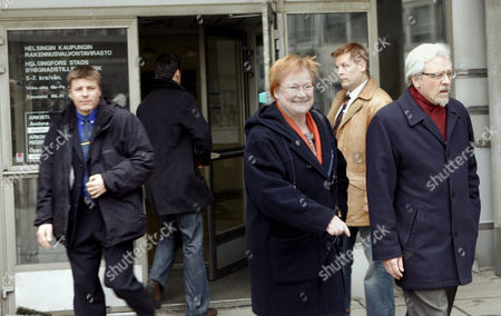 Finnish President Tarja Halonen and husband Dr Pentti Arajarvi leave after casting their ballots in Parliamentary Elections. The Finnish election is expected to be a tight race between Center Party, its left-leaning coalition partner Social Democratic Party and the Conservative opposition