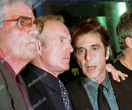 """ROCCO Actor Al Pacino, right, James Caan, center, and Alex Rocco, left, pose for pictures before attending at the 25th anniversary premiere of """"The Godfather"""" at San Francisco's Castro Theater"""