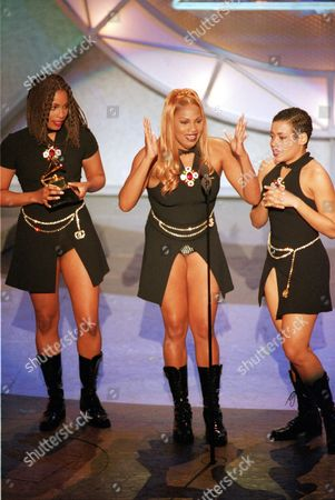 "Denton Roper James Dede Roper, left, Sandy Denton, center, and Cheryl James of the pop group Salt n' Pepa give their acceptance speech at the 37th annual Grammy Awards at the Shrine Auditorium in Los Angeles, Ca., on . The female trio won for Rap Duo or Group Performance for the song ""None of Your Business"