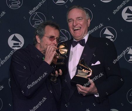 MOSS ALPERT TRUSTEE Herb Alpert, left, makes a trumpet of his Grammy award alongside Jerry Moss, as the two hold their Trustee Awards during the 39th Annual Grammy Awards in New York Wednesday afternoon