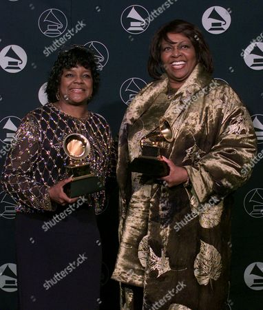 """CAESAR HOUSTON Shirley Caesar, left, holds her award for Best Gospel Album by a Choir or Chorus for """"Just A World,"""" alongside Cissy Houston with her award for Best Traditional Soul Album for """"Face to Face,"""" during the 39th Annual Grammy Awards in New York Wednesday afternoon"""