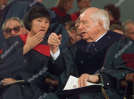 LIN ANNENBERG Sculptor-architect Maya Lin, left, designer of the Vietnam Memorial in Washington, D.C., speaks with publisher-philanthropist Walter H. Annenberg prior to receiving their honorary degrees during commencement ceremonies at Harvard University in Cambridge, Mass., . Lin received an honorary Doctor of Arts degree while Annenberg received an honorary Doctor of Law degree