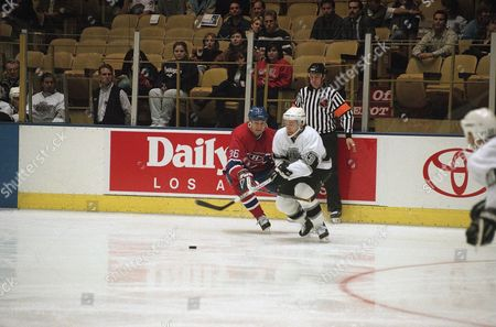 Stock Picture of Murray Baron, Vitali Yachmenev Montreal Canadian Murray Baron (36) and Los Angeles King Vitali Yachmenev (43) scramble for the puck during the first inning at the Forum in Inglewood, California on
