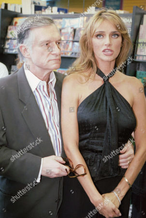 Stock Image of Playboys Hugh Hefner, left, and his wife Kimberley Conrad Hefner speak to the media at a presentation of a join project with People for the Ethical Treatment of Animals (PETA) to promote human organ donations, Los Angeles, Calif