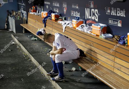 Los Angeles Dodgers' Joe Blanton sits in the dugout during the seventh inning of Game 5 of the National League baseball championship series against the Chicago Cubs, in Los Angeles