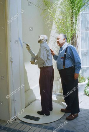 Stock Picture of Jonathan Winters Comedian Jonathan Winters asks: ?Are you finished?? as he takes a tour around a look-a-live garden statue ?Weekend Painter,? by J. Seward Johnson Jr., at a Beverly Hills hotel on