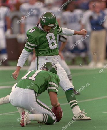 Stock Photo of LOWERY HANSEN New York Jets placekicker Nick Lowery (8) kicks a 42-yard first-quarter field goal off the hold by Brian Hansen (11) against the Indianapolis Colts in Indianapolis on . Indianapolis won the game 17-10