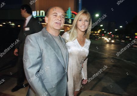 Actor Joe Pesci, left, arrives at the world premiere of his new movie ?Eight Heads in A Duffel Bag? with Leighanne Wallace in the Westwood section of Los Angeles on . The comedy has Pesci faced with an unusual twist on the frequent flyer?s pesky problem of identical luggage switched at an airport baggage claim