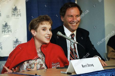 "Kerri Strug of the 1996 Olympic Gold Medal-winning U.S. gymnastics team speaks at a news conference on in Los Angeles to announce her participation in ""The Magic of MGM,"" an Ice Capades touring production that will feature skaters and gymnasts showcasing memorable movies, music and characters from the MGM film library. Behind Strug is her agent Leigh Steinberg"