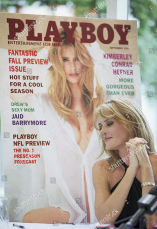 Stock Picture of Kimberly Conrad Hefner, wife of Hugh Hefner, poses with a poster of Playboy magazine, to celebrate her first appearance in five years in the September issue, which goes to sale, . Hefner also unveiled an ad for the people for the Ethical Treatment of Animas (PETA), which teamed up with Playboy magazine to launch a landmark human organ donor drive to prevent unwilling animal donors from being killed