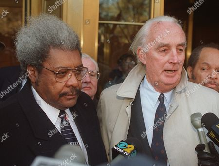 KING Boxing promoter Don King, left, and his lawyer, Peter Fleming, Jr., right, face reporters outside U.S. District Court in New York . King, who has already survived three grand jury probes and an FBI sting, won another legal victory when prosecutors withdrew their appeal of a mistrial ruling in his insurance fraud trial