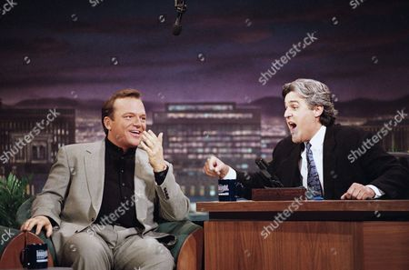 """Actor Tom Arnold, left, speaks with """"The Tonight Show"""" host Jay Leno about the turmoil of the last few days with his wife Roseanne in Burbank, Calif., . Arnold said that he wanted to repair his split with Roseanne even though she threw all his stuff in the pool"""