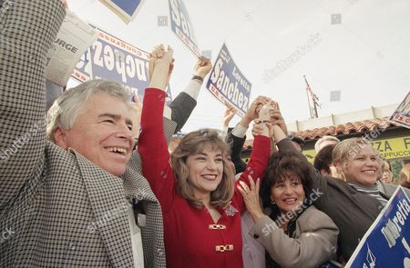 Editorial photo of Loretta Sanchez raises her arms in victory, Garden Grove, USA