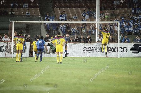 Luis Roberto Alves Luis Roberto Alves (17), of Mexico's Club America, jumps in the air after a penalty kick against El Salvador's international team goalie Raul Antonio Garcia during their exhibition game on at the Coliseum in Los Angeles. Watching the goal are Club America's Maurizio Gaudino (23), Oman Biyik (9), El Salvador's Jorge Humberto Rodriguez (5), and German Villa (13
