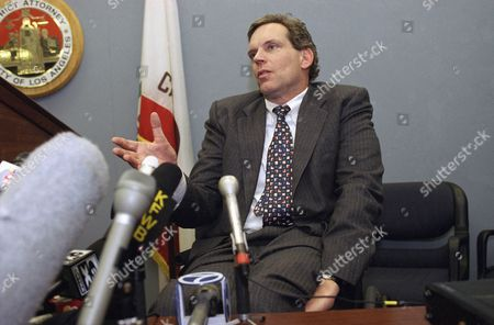 """Nicholas DeWitt, attorney for rock star Madonna, talks with the news media following the conviction on all five counts of the man accused of stalking her at the Los Angeles Criminal Courts building, . DeWitt read a statement from Madonna, which said, """"I hope the outcome of this helps stalking victims know that the system can and does work"""
