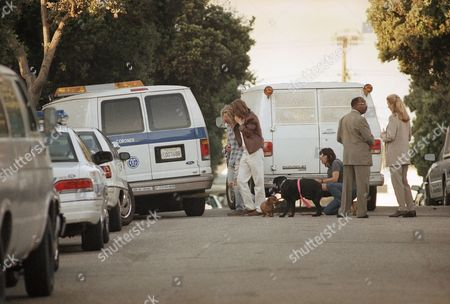 Unidentified friends grieve near the coroner's van containing the body of Margaux Hemingway outside her apartment in Santa Monica, California on . Hemingway's body was discovered earlier Monday after concerned friends had not heard from her since last Friday