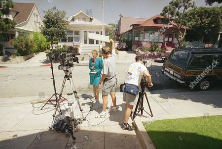 Members of the media set up for live news broadcasts across the street from actress-model Margaux Hemingway's apartment (upstairs unit in the driveway of house to the right) on Fraser Ave. in Santa Monica, California on . Hemingway was found dead in her apartment on Monday after concerned friends had not been her since last Friday. It was unclear what killed Hemingway, who was 41, but police Sgt. Gary Gallinot said there was no sign of foul play and no illegal drugs were found