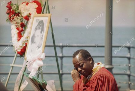 Reverend Bill Minson, of the Urban Domestic Affairs of the Young Cyberchurch, wipes tears away after his comments on Margaux Hemingway during a memorial service on for the actress-model at the Santa Monica, California, pier found in her Santa Monica apartment earlier this month