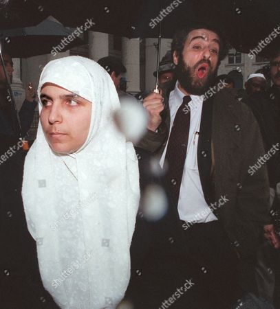 MARZOOK COHEN Nadia Marzook, wife of Mousa Mohammed Abu Marzook, the head of Hamas' political wing, and his attorney Stanley Cohen face the media outside federal court in Manhattan after a hearing . Marzook, 45, was to appear before U.S. District Judge Kevin Duffy for a procedural hearing on the U.S. government's bid to extradite him to Israel, where he could be tried as an alleged terrorist. Marzook did not appear at the hearing Friday