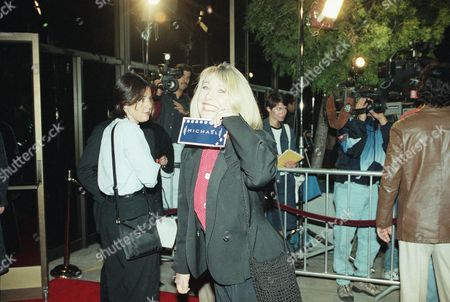 "Actress Teri Garr shows off her ticket at the premiere of ?Michael,"" in Beverly Hills, Calif. The film co-stars Garr and stars John Travolta along with William Hurt, Robert Pastorelli and Jean Stapleton"