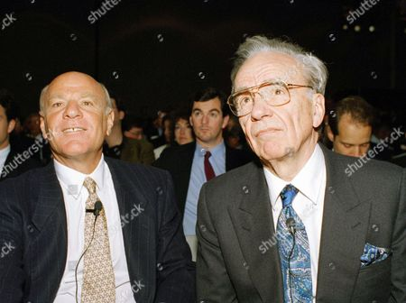 Industry leaders Rupert Murdoch, chairman of Fox Inc., right, and Barry Diller, former QVC, Inc. chairman, listen as ABC-TV commentator Jeff Greenfield introduces them to conduct one-on-one conversations during the National Association of Broadcasters convention, in Las Vegas. During the talk, Murdoch urged broadcasters to provide free air time to political candidates