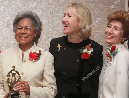 ROBINSON PATAKI CASTRO Rachel Robinson, left, of the Jackie Robinson Foundation, holds her awards statuette with New York state's first lady Libby Pataki, center, and Bernadette Castro, commissioner of the New York state Office of Parks, in New York. Robinson, Pataki and Castro were among the women awarded Outsanding Mother honors for 1997 by the National Mother's Day Committee