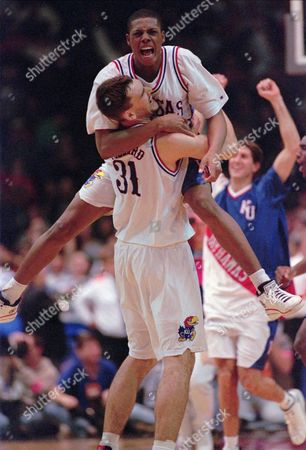 POLLARD PIERCE Kansas Wildcats forward Paul Pierce (34) leaps into the arms of teammate Scot Pollard (31) after Kansas defeated the Arizona Wildcats 83-80 in the NCAA West Regional semi-final game in Denver on . Kansas will play Syracuse in the final game on Sunday
