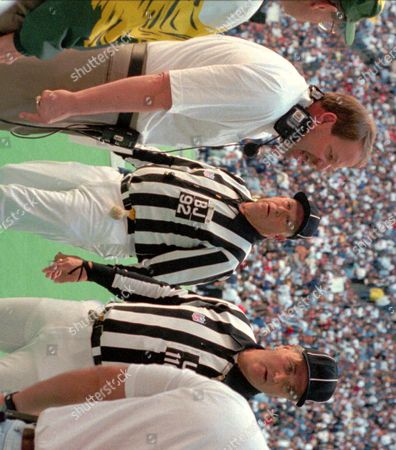 HOLMGREN Green Bay Packers coach Mike Holmgren, left, shouts from the sidelines with referees Jim Poole, center, and Ron Botchan watching, during the NFC Championship game against the Dallas Cowboys, in Irving, Texas. The Packers lost to the Cowboys 38-27