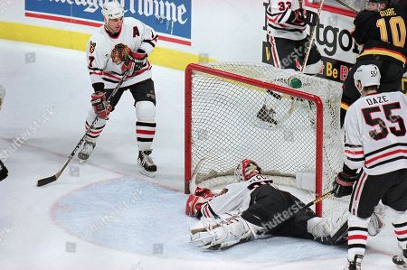 Chicago Blackhawks goalie Ed Belfour tries to stop the shot by Vancouver Canucks' Trevor Linden during the second period of the teams' second-round playoff game, in Chicago. The replay official ruled the shot a goal