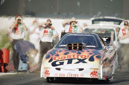 Funny car racer John Force, of Yorba Linda, Calif., starts before he set an event record speed, during a qualifying round for the National Rod Association Winston Select finals at the Pomona Raceway in Pomona, Calif., . Force clocked a 305.7 mph