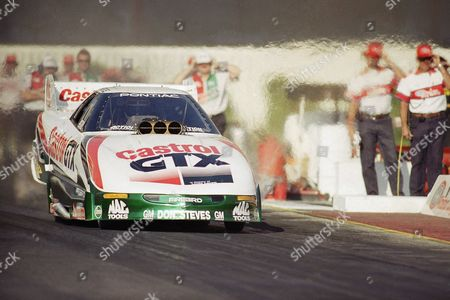 Funny car racer John Force starts for an eighth place finish during a qualifying round for the National Rod Association Winston select finals at the Pomona Raceway in Pomona, Calif