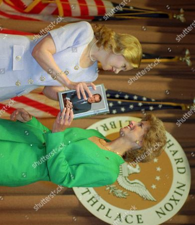 "NIXON Tricia Nixon Cox, daughter of Richard Nixon, presents a copy of her late father's book, ""Leaders,"" to New Jersey Gov. Christine Whiteman, right, at the close of Whitman's speech at the Richard Nixon Library and birthplace in Yorba LInda, Calif., on"