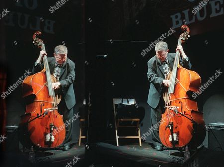 Stock Photo of Jazz bassist Charlie Haden, right, and his plexiglas reflection as he rehearses during a soundcheck at the House of Blues in West Hollywood, Calif., before a performance by his band Quartet West. Haden died in Los Angeles after a long illness. He was 76