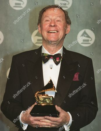GORDON At New York's Radio City Music Hall, who wrote ''Unforgettable'' and won a Grammy for it four decades later after Natalie Cole recorded it as a duet with her late father, has died at age 81. Gordon, shown holding his Grammy for Song of the Year, whose songs also were recorded by such greats as Duke Ellington, Billie Holiday and Patti Page, died of cancer at his home in Los Angeles on Sunday, said his son, William Gordon. He was 81