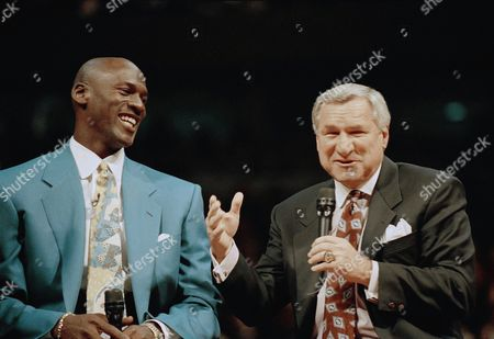 """Michael Jordan, Dean Smith Former Chicago Bulls great Michael Jordan shares a moment with Dean Smith, his former coach at North Carolina, during ceremonies honoring Jordan at Chicago's United Center. Smith, the North Carolina basketball coaching great who won two national championships, died """"peacefully"""" at his home Saturday night, Feb. 7, 2015, the school said in a statement Sunday from Smith's family. He was 83"""