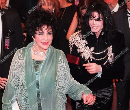 TAYLOR JACKSON Elizabeth Taylor arriving with Michael Jackson at the Pantages Theater in Los Angeles for her birthday celebration. Publicist Sally Morrison says the actress died in Los Angeles of congestive heart failure at age 79