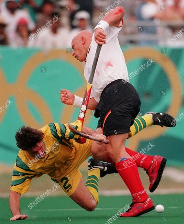 DAVIES FISCHER Carsten Fischer, right, of Germany, and Stephen Davies, of Australia, struggle for control of the ball during their bronze medal field hockey game at the Centennial Summer Olympics in Atlanta . Australia went on to win the bronze medal with a score of 3 to 2 over Germany
