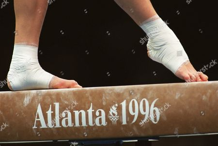 Stock Image of STARK The feet of Germany's Kathleen Stark grace the balance beam during a gymnastic practice session Tueday, in Atlanta Ga. The 1996 Olympic Summer Games are set to begin on July 19