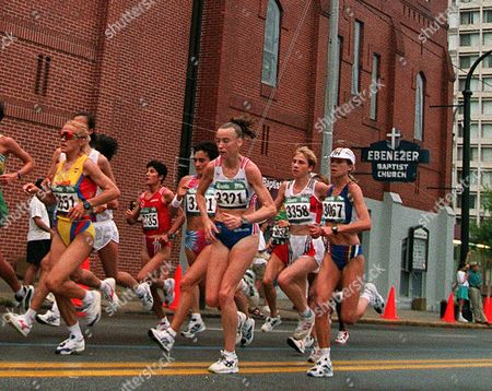 Participants in the women's marathon run past Ebenezer Baptist Church during the Centennial Summer Olympics in Atlanta . At right is Marleen Renders of Belgium (3067), 2nd right is Germany's Sonja Krolik (3358), in front of them is Britain's Liz McColgan (3321
