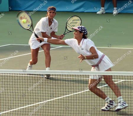 FERNANDEZ America's doubles team of Mary Joe Fernandez, left, and Gigi Fernandez return to the Czech Republic's doubles team of Jana Novotna and Helen Sukova in the gold medal match at the Stone Mountain Tennis Center