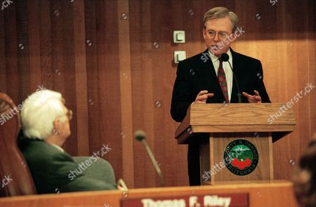 Thomas Hayes, right, the former State Treasure hired to review Orange County's financial calamity, stressed that it is important that we do not panic, as he speaks at a special Orange County Board of Supervisors meeting, Santa Ana, Calif. Listening is Thomas Riley, chairman of the Orange County Board of Supervisors