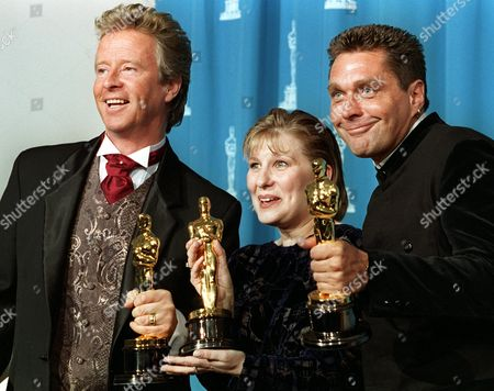 """FRAMPTON BURWELL FRAMPTON Peter Frampton, left, Lois Burwell, center, and Paul Pattison hold their Oscars for Achievement in Makeup for """"Bravehart,"""" backstage at the 68th Annual Academy Awards, in Los Angeles"""