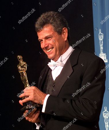 "SEALE John Seale poses for photographers backstage at the 69th annual Academy Awards in Los Angeles . Seale won an Oscar for Achievement in Cinematography for ""The English Patient"