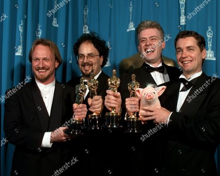 """COX Left to right, Scott E. Anderson, Charles Gibson, Neal Scanlan and John Cox smile for photographers backstage after winning for Best Achievement in Visual Effects for """"Babe"""", at the 68th Academy Awards at the Music Center in Los Angeles"""
