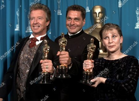 """BURWELL FRAMPTON PATTISON Peter Frampton, left, Paul Pattison, center, and Lois Burwell smile for photographers backstage after winning for Best Achievement in Makeup for """"Braveheart"""" at the 68th Academy Awards at the Music Center in Los Angeles"""