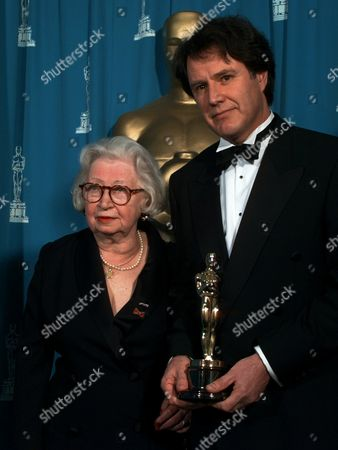 """GIES Miepge Gies and Jon Blair pose for photographers backstage after Blair won for Best Documentary Feature for """"Anne Frank Remembered"""", at the 68th Academy Awards at the Music Center in Los Angeles, . Gies found the original Anne Frank diary at the Frank's home in Amsterdam and made it public"""