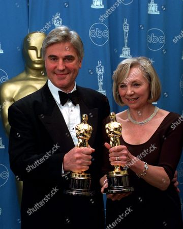 "CRAIG MCMILLAN Stuart Craig and Stephenie McMillan pose for photographers after winning for Best Art Direction for ""The English Patient"" at the 69th annual Academy Awards in Los Angeles"