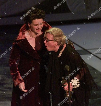"ROTH BINOCHE Presenter Juliette Binoche gives Ann Roth, right, the Oscar for Best Costume Design for ""The English Patient,"" at the 69th Annual Academy Awards at the Shrine Auditorium in Los Angeles, . Binoche also won as Best Supporting Actress for her role in ""The English Patient"