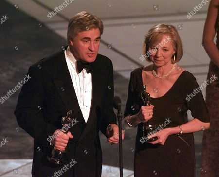 "MCMILLAN Stuart Craig and Stephenie McMillan accept the award for Best Art Direction for ""The English Patient,"" at the 69th Annual Academy Awards at the Shrine Auditorium in Los Angeles"