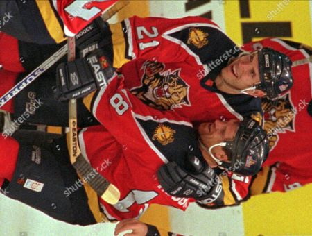 TOM FITZGERALD Florida Panthers Mike Hough, right, is embraced by teammate Tom Fitzgerald after scoring the winning overtime goal against the Philadelphia Flyers in Philadelphia, Hough scored the goal in the second overtime period